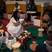 Ethiopian Woman Serving Traditional Coffee At Bit 2014, International Tourism Exchange In Milan, Ita