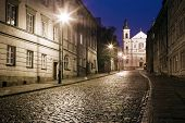 picture of tenement  - The street of the old town in Warsaw at night - JPG