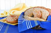 Whole Wheat Bagel And Bread In A Basket.