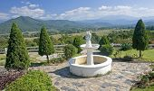 View Of The White Fountain In The Background Of Mountains In Pai