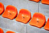 Closeup Of Red Sport Stadium Seats. Empty Stand. Team Sport Supporter