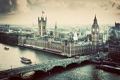 London, the UK. Big Ben, the Palace of Westminster in vintage, retro style. The icon of England. View from the London Eye