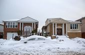 Car and house under snow after massive winter storms strikes Northeast