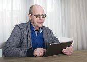 Old man on tablet pc
