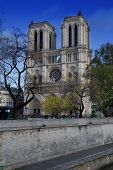 image of mona lisa  - Unfinished Cathedral Notre Dame in day time in Paris France - JPG