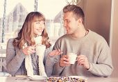 Couple Is Drinking Coffee In Cafe