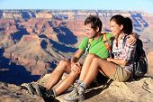 Hiking couple portrait - hikers in Grand Canyon enjoying view of nature landscape smiling happy. You