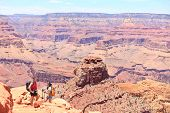 Grand Canyon hiking people. Hiker couple enjoying hike and view on South Kaibab Trail, south rim of