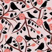 seamless background with branches, lisityami, birds and flowers