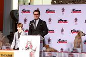 LOS ANGELES - FEB 14:  Max Charles, Ty Burrell at the Mr. Peabody honored with Pawprints in Cement a