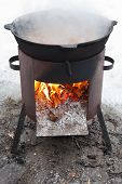 Cooking Stew On Outdoor Mobile Brazier
