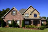 Large Upscale Brick Surburban Home