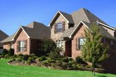stock photo of residential home  - A fully landscaped brick home somewhere in the Midwest - JPG