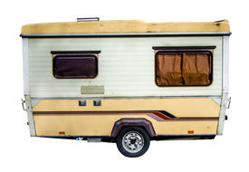 stock photo of caravan  - Isolation Of A Retro Grungy 70s Caravan - JPG