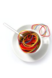stock photo of rubber band  - Abstract metaphor of colorful rubber bands in breakfast cup - JPG