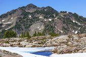 Red Mountains Small Blue Snow Pool Artist Point Washington State
