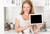 Woman Housewife In The Kitchen With An Blank Empty Tablet Computer