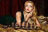 Blond woman playing chess