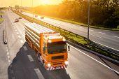 Orange Truck In Motion Blur On The Highway