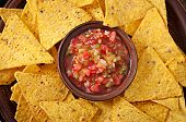 pic of nachos  - Mexican nacho chips and salsa dip in bowl on wooden background - JPG