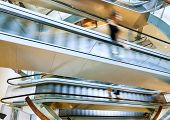 People In Motion In Escalators