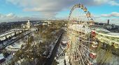 MOSCOW, RUSSIA - NOVEMBER 30, 2013: Amusement park and the Central Pavilion in Russia Exhibition Center, aerial view. The park was created in 1995 for the 850 anniversary of Moscow