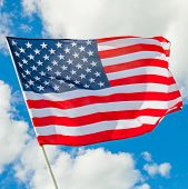 Usa Flag With White Clouds On Background