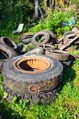 Heap of used tires on junkyard