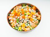 foto of peas  - Frozen carrots maize and peas thawing in a steel bowl - JPG