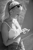 Attractive teenage girl using smartphone outdoor