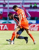 Sisaket Thailand-august 3: Victor Amaro Of Sisaket Fc. (orange) In Action During Thai Premier League