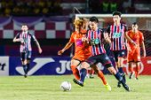 Sisaket Thailand-august 3: Nuttawut Khamrin Of Sisaket Fc. (orange) In Action During Thai Premier Le