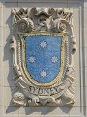 Mosaic shield of renowned port city Sydney at the facade of United States Lines-Panama Pacific Line