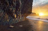 Beautiful sunset. Evening landscape at the sea. Rocks on the coast