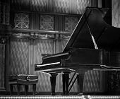 stock photo of grand piano  - Calssic concert grand piano on stage of concert hall on black in white - JPG