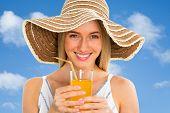 Pretty woman with orange juice