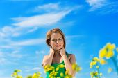 blond woman in a rape field