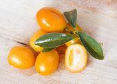 Kumquat Over Wooden Background