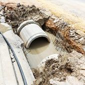 foto of septic  - Close up sewer installation in city at daytime - JPG