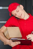 Busy Courier Calling On Mobile Phone
