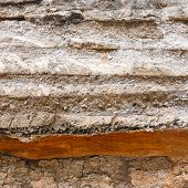 foto of backhoe  - Close up soil layers under asphalt road dug by a backhoe - JPG