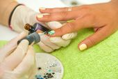 Woman getting her manicure done