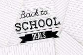 Back to school deals message against lined paper strewn over surface