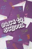 Back to school message against purple paper strewn over notepad