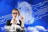 Thinking redhead businesswoman against fingerprint on digital blue background
