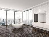 Modern white minimalist bathroom interior with a freestanding bath tub and recessed wall alcove with