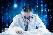 Mature businessman typing on keyboard against lines of blue blurred letters falling