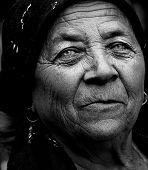 Dark Artistic Portrait Of Expressive Senior Woman