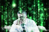 Focused businessman with magnifying glasses against lines of green blurred letters falling