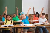 foto of pupils  - Cute pupils raising their hands at the elementary school - JPG